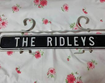 The Ridleys sign fence post or repurposed