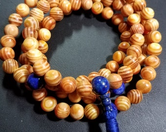 108 ct. 8mm Indonesian Kingwood with Lapis Lazuli  Markers and Guru Bead