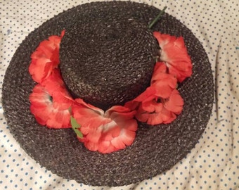Vintage black straw wide brimmed hat. Bright pink flowers around top. Horners in Roanoke Virginia. Kentucky Derby Hat.