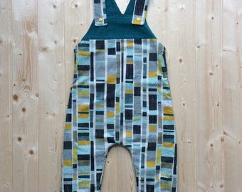 Reversible baby cord dungarees.