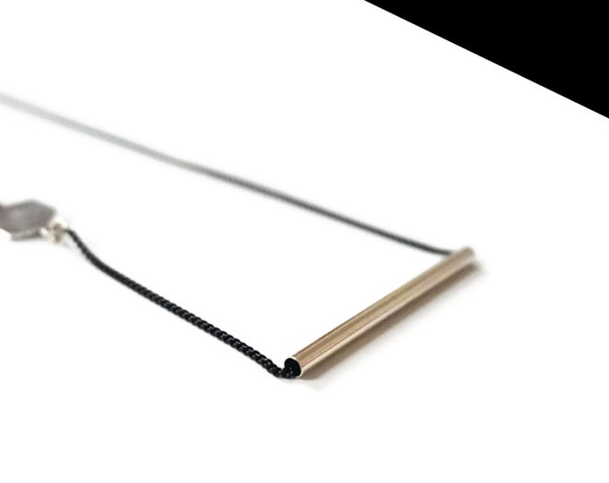Silver arrow necklace.