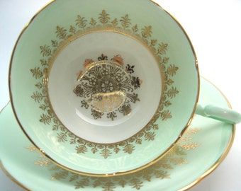 Royal Grafton Mint Green and gold Tea Cup And Saucer, Gold Medallion and gold Filigree tea cup and saucer.