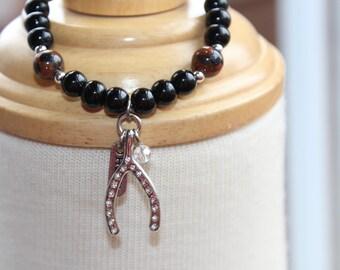 """Elastic bracelet, lifestyle """"make a wish""""."""