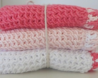 Set of three hand knitted wash cloths - 100% cotton - pinks and white with contrasting crochet edging.