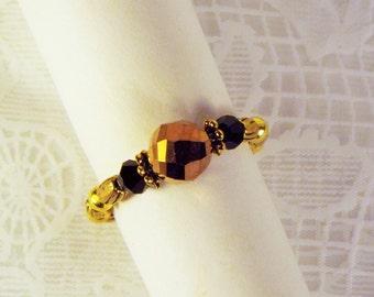 """Cynthia Lynn """"WILDFIRE"""" Gold Tone Black Copper Crystal Beaded Stretch Ring"""