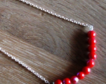 Silverplaited chain in combination with red glass beads !