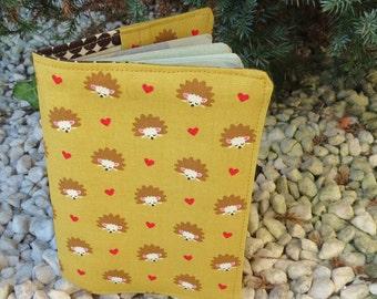 Hedgehogs.  A passport sleeve with a hedgehogs design.  Passport cover.