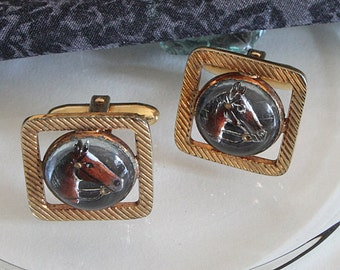 Vintage cufflinks stained with horse
