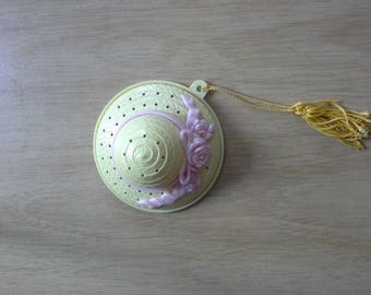 Yellow avon pomander in the shape of a hat