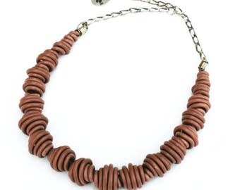 Upcycled jewelry. Beige necklace made from recycled electric cables MACAU