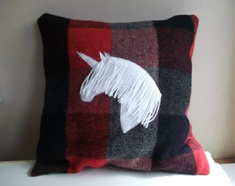 Handmade cushion, unicorn stitched onto a wool fabric in red and black
