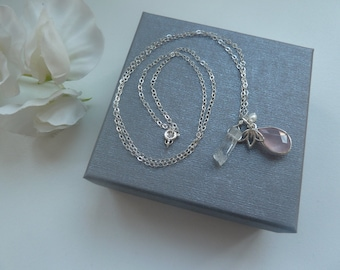 Long sterling silver chain necklace with rose quartz pendant and charms