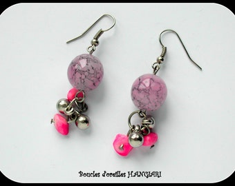 Pink agate earrings veined in black, mother-of-pearl pendants, and silver charms