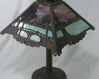 Antique Bradley Hubbard slag glass table lamp lighthouse and bridge scene blue green stained B&H