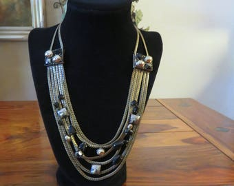Gorgeous Vintage Six Strand Gold  Bronze Chain Necklace Accented With Black And Silver Faux Gems