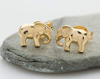 Gold Elephant Stud Earrings. Matching necklace also available.