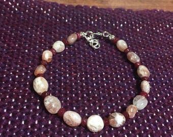 Strawberry quartz and garnet beaded bracelet. 7 inch