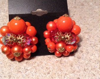 Vintage orange beaded clip on earrings
