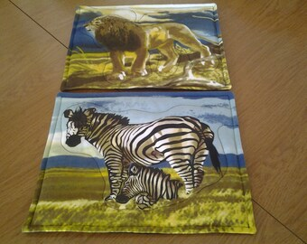 Fabric Placemats...Out-Of-Africa,  Machine Quilted.. Set of Six, Cheetah, Leopard, Zebra, Giraffe and Lion with a black Backing