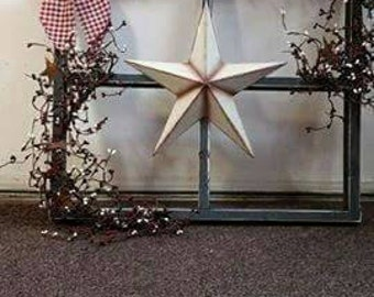 Handmade wooden primitive window frame with pip berries and star
