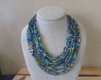 Multiple strands glass bead necklace wood closure