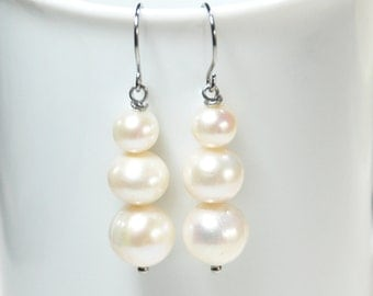 Natural white freshwater pearl statement earrings on stainless steel