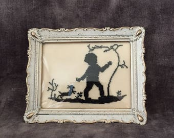 Vintage needlepoint embroidery of child and bunny in a french provincial frame convex bubble glass