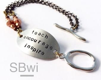Teacher bracelet in aluminum with copper detail