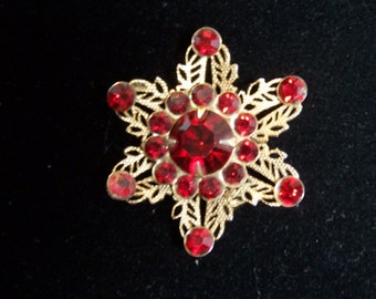 Vintage red and gold snowflake pin