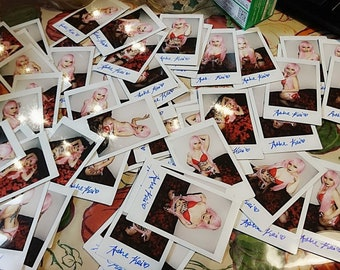 Signed Polaroids