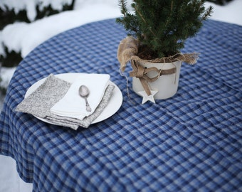 Simply finished soft washed linen tablecloth with blue-checkered ornament