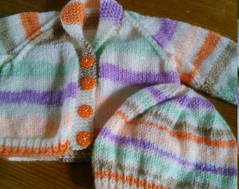 Cute cardigan and matching hat to fit newborn up to 6-8 pounds.