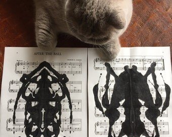 Six Black Inkblot Paintings on Antique Sheet Music, With Song Titles