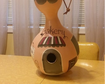 Handpainted bakery gourd birdhouse...showing desserts in the window..