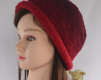 Lady's knitted hat - cloche style with roll-up brim - burgundy and red variegated
