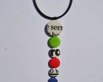 Caoutchouc statement necklace with multicolor buttons fabric lined
