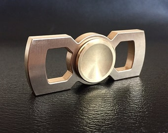 Rotobow - brass hand spinner