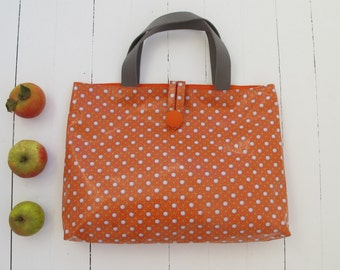 Coated canvas tote shiny small Pan grey stars on an orange background.