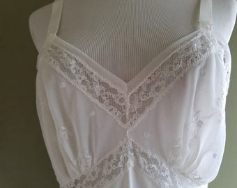 Pretty White 1950's full slip by Aristocraft. Chiffon 100% Nylon. Small to Medium.