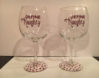 "2 wine glasses ""Define Naughty"", bottom are painted wine colored polka dots"