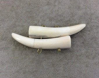 """4"""" White/Ivory Mirrored Double Antler Tusk Shaped Natural Ox Bone Pendant with Four Suspension Rings - Measuring 104mm x 33mm - (TR4WHDMANT)"""