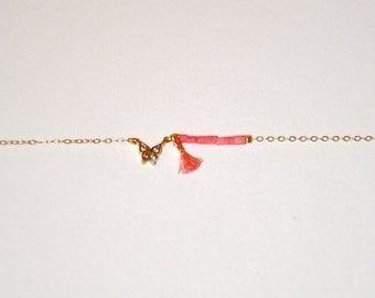 Vintage bracelet very fine gold plated with pink stones and small butterfly