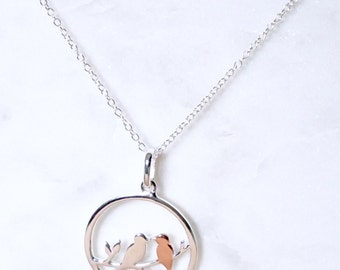 Sterling silver necklace with lovebirds perched on a branch