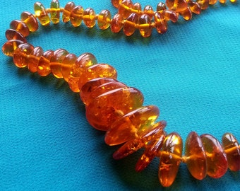 Disk shaped amber beads. Mid length necklace. Honey coloured Baltic amber. Vintage beads. Neat and Lightweight.