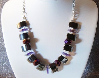 Black hematite with purple crystals and lavender glass spikes.