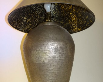 Modern textured brass urn lamp with unusual gold scroll lined shade.