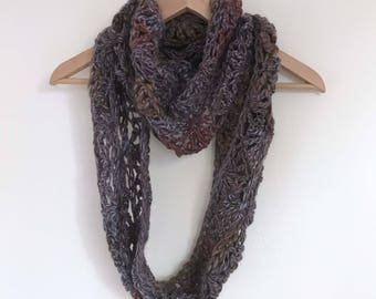 Shell chunky crochet scarf in a mixed shade yarn in red, purple and brown. Original design versatile infinity scarf