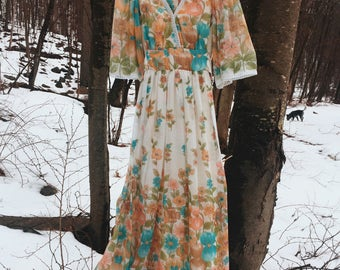 "70's stunning floral maxi, angel sleeves, soft floaty fabric, lined skirt and ties in the back. by ""This Is Yours"" San Francisco"