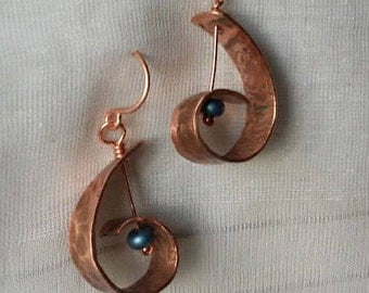 Curled hammered copper coiled teardrop artisan organic earrings with blue beads