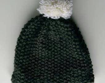 Knitted grey hat with white pom pom